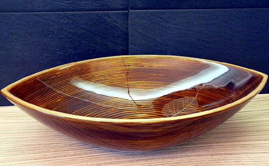 Unique sink designs in wood with elegant rounded shapes