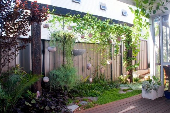 Vertical gardens provide a delightful retreat in the backyard