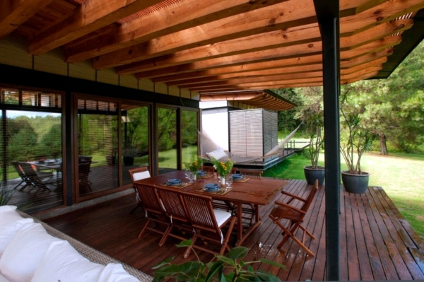 Wooden House With Glass Facade Thrilled With Scenic Views
